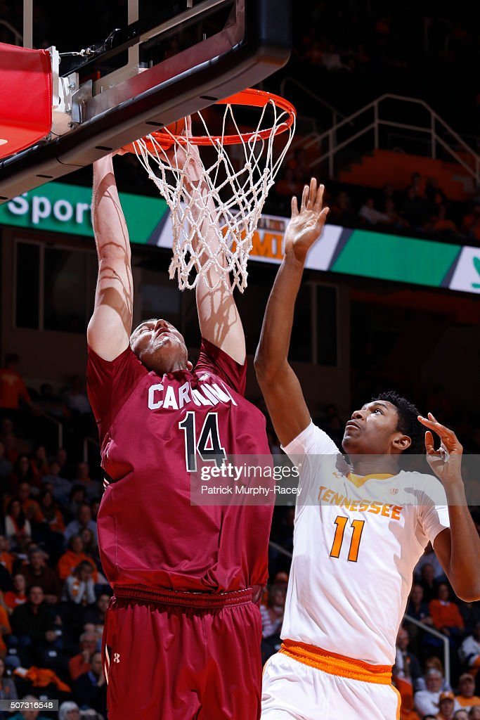 Laimonas Chatkevikius #14 of the South Carolina Gamecocks dunks on Kyle Alexander #11 of the of the Tennessee Volunteers in a game at Thompson-Boling Arena on January 23, 2016 in Knoxville, Tennessee.