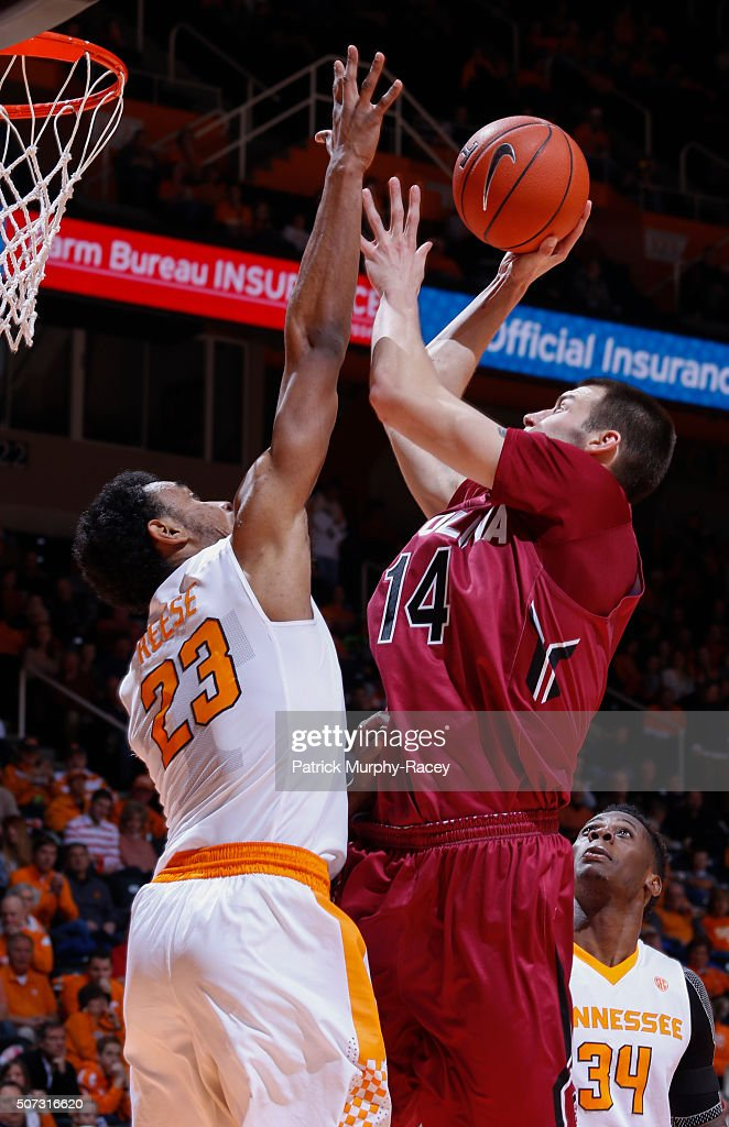 Laimonas Chatkevikius #14 of the South Carolina Gamecocks shoots over Derek Reese #23 of the Tennessee Volunteers shoots against in a game at Thompson-Boling Arena on January 23, 2016 in Knoxville, Tennessee.