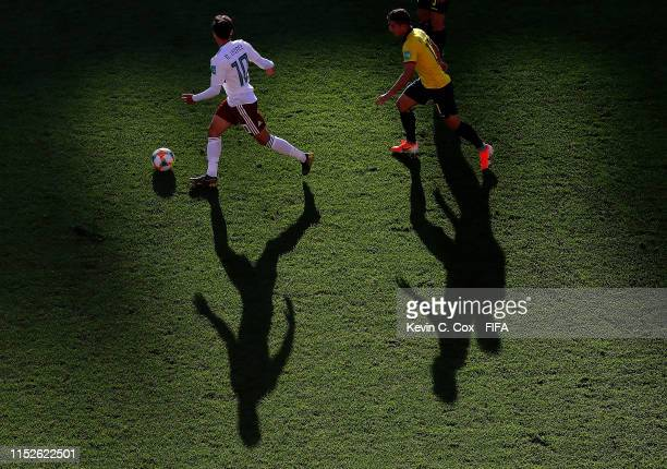 D Lainez of Mexico in action against Alexander Alvarado of Ecuador during the 2019 FIFA U20 World Cup group B match between Ecuador and Mexico at...
