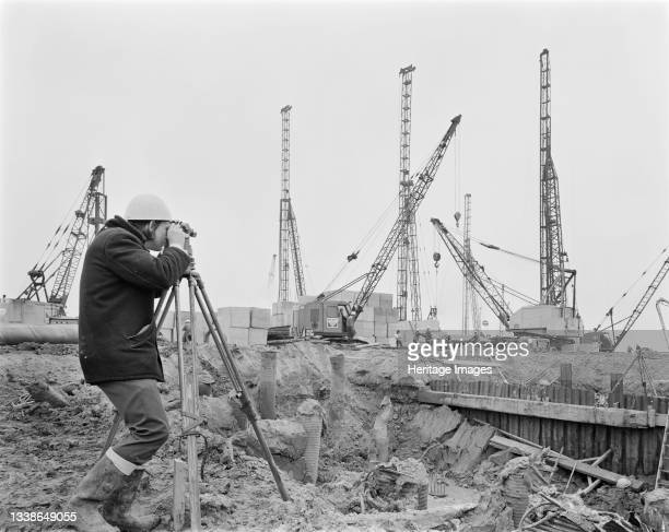 Laing surveyor using a theodolite on the construction site of the Isle of Grain Power Station. The Isle of Grain Power Station was an oil fired power...