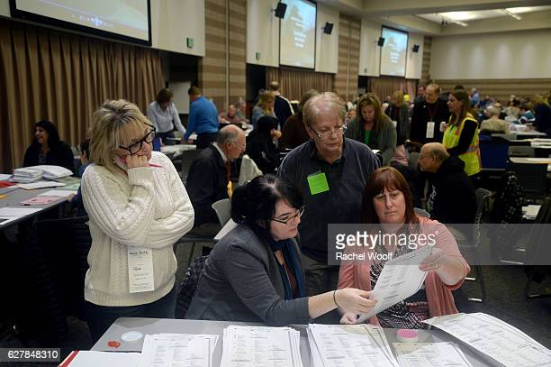 Lainie Smith of Commerce Aileen Dickson City Clerk of Troy Donna Glowacki of Lake Orion and Cheryl Stewart of Troy recount presidential ballots at...