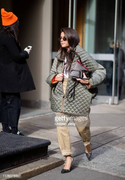 Lainy Hedaya is seen wearing olive puffer jacket beige pants outside Jason Wu during New York Fashion Week Autumn Winter 2019 on February 08 2019 in...