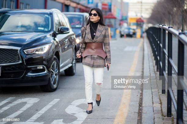 Lainy Hedaya wearing white pants, corset, checked blazer seen outside Creatures of Comfort on February 8, 2018 in New York City.
