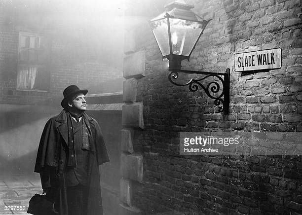 Laird Cregar an American character actor is looking at the street sign for 'Slade Walk' in a scene from 'The Lodger' set in the time of Jack the...