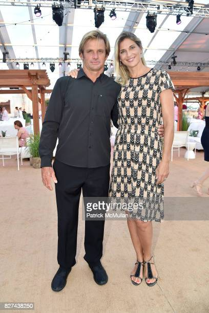 Laird Hamilton and Gabby Reece attend Sixth Annual Hamptons Paddle and Party for Pink Benefitting the Breast Cancer Research Foundation at Fairview...
