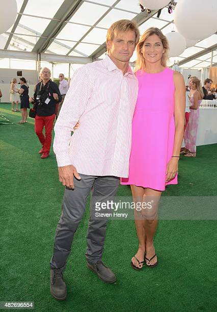 Laird Hamilton and Gabrielle Reece toasts to Paddle for Pink with Moet Ice Imperial on August 1 2015 in Bridgehampton New York