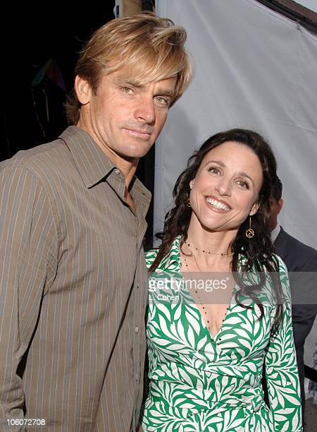 Laird Hamilton and Julia LouisDreyfus during Heal the Bay Bring Back the Beach Arrivals at Barker Hanger in Santa Monica California United States
