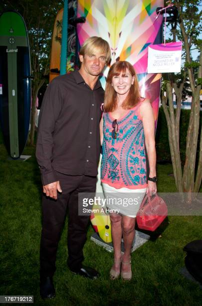 Laird Hamilton and Nicole Miller attend the 2nd annual Paddle Party for Pink on August 17 2013 in Sag Harbor New York