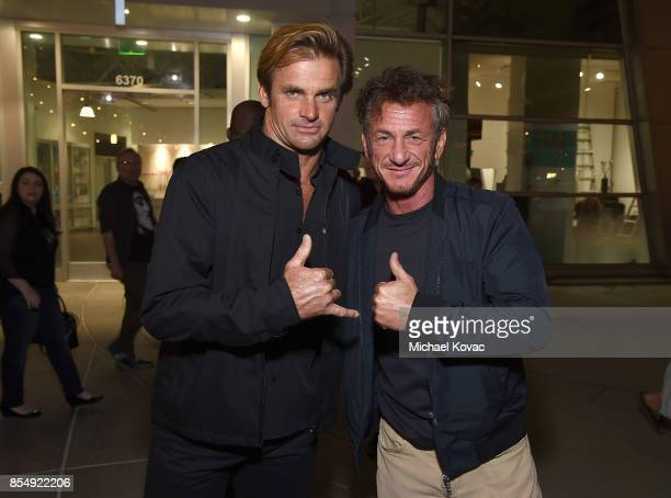 Laird Hamilton and Sean Penn attend the Los Angeles premiere of 'Take Every Wave' at ArcLight Cinemas on September 27 2017 in Hollywood California