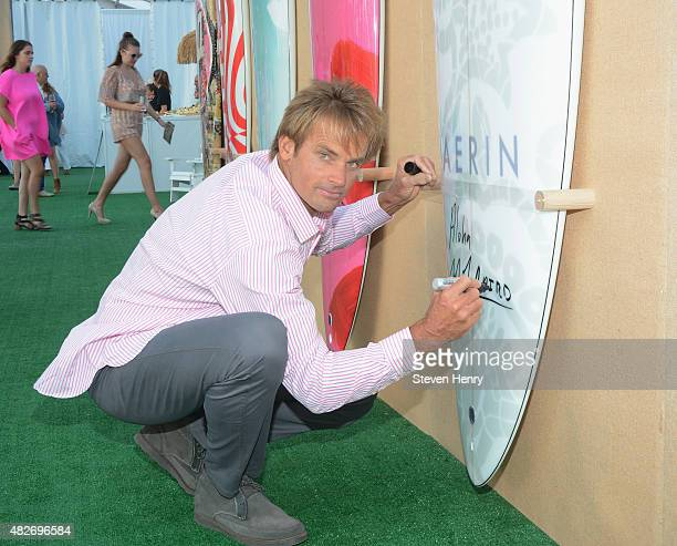 Laird Hamilton toasts to Paddle for Pink with Moet Ice Imperial on August 1 2015 in Bridgehampton New York