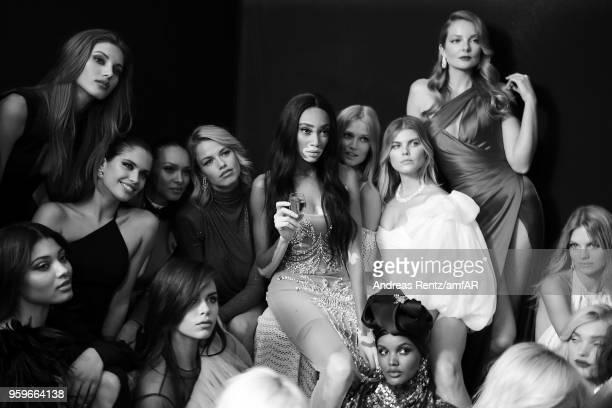 Lais Ribeiro Sara Sampaio Hailey Clauson Winnie Harlow Toni Garrn Halima Aden and Eniko Mihalik pose backstage at the amfAR Gala Cannes 2018 at Hotel...