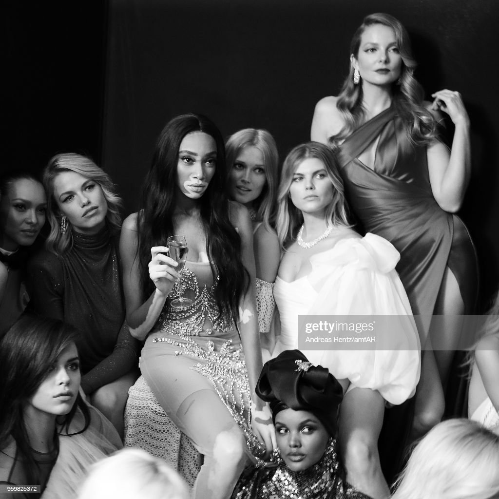 (L-R) Lais Ribeiro, Sara Sampaio, Hailey Clauson, Winnie Harlow, Toni Garrn, Halima Aden, and Eniko Mihalik pose backstage at the amfAR Gala Cannes 2018 at Hotel du Cap-Eden-Roc on May 17, 2018 in Cap d'Antibes, France.