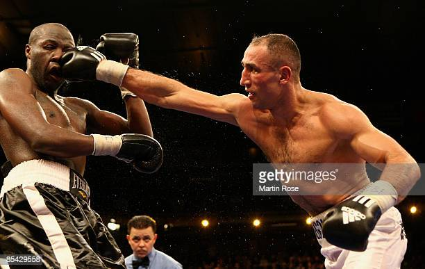 Lajuan Simon of the U.S. Is hit with a straight right by Arthur Abraham during their IBF World Championship Middleweight fight at the Sparkassen...