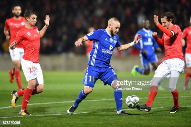 Lakdar Boussaha of Bourg en Bresse and Fethi Harek of Nimes during the Ligue 2 match between Nimes and Bourg en Bresse at Stade des Costieres on...