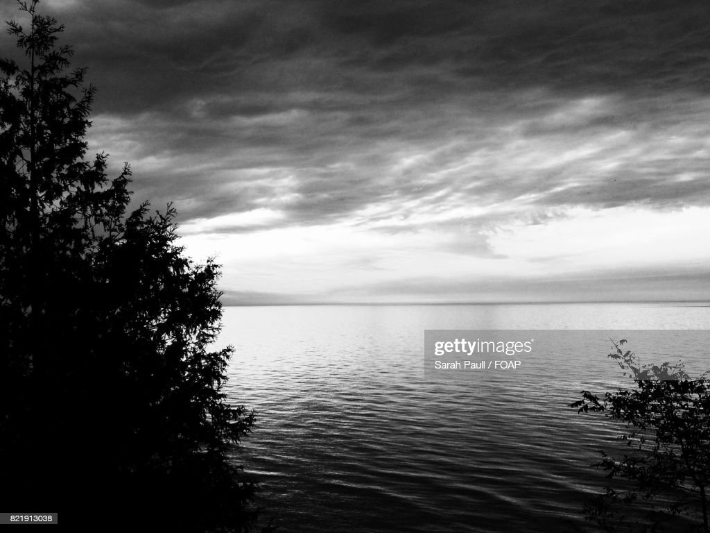 Lake against cloudy sky : Stock Photo