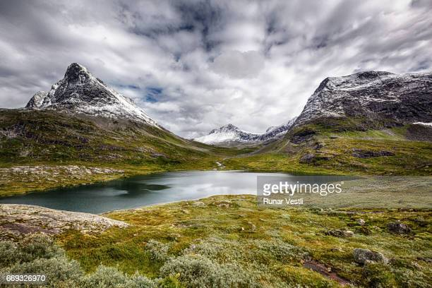 lake alnesvatnet - valley stock pictures, royalty-free photos & images
