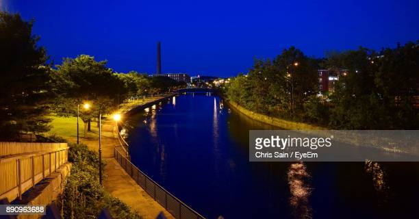 lake amidst trees against blue sky at night - lowell massachusetts stock pictures, royalty-free photos & images