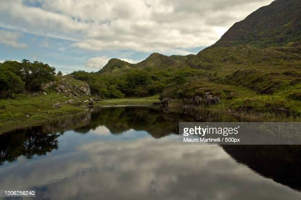 lake and green hills, ireland - martinelli stock pictures, royalty-free photos & images