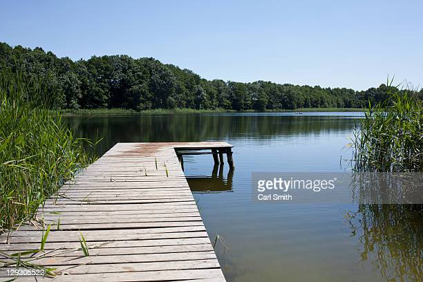 lake and jetty - jetty stock pictures, royalty-free photos & images