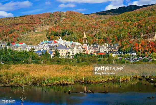 lake and mont tremblant resort village, laurentians, quebec, canada - mont tremblant stock pictures, royalty-free photos & images