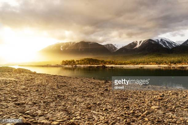 lake and mountain covered snow  with sunrise - lakeshore stock pictures, royalty-free photos & images