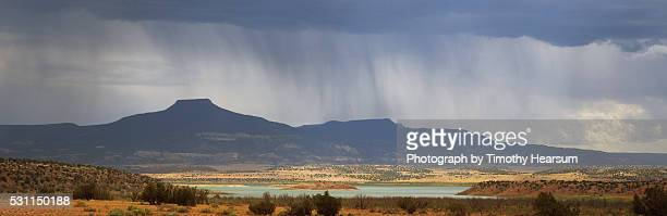 lake and mountains in rain storm - timothy hearsum stock pictures, royalty-free photos & images