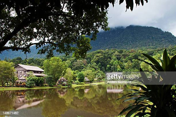 lake and tribal buildings at sarawak cultural village near kuching. - sarawak state stock pictures, royalty-free photos & images