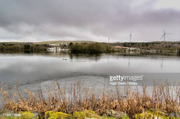 lake and wind power - nigel owen stock pictures, royalty-free photos & images