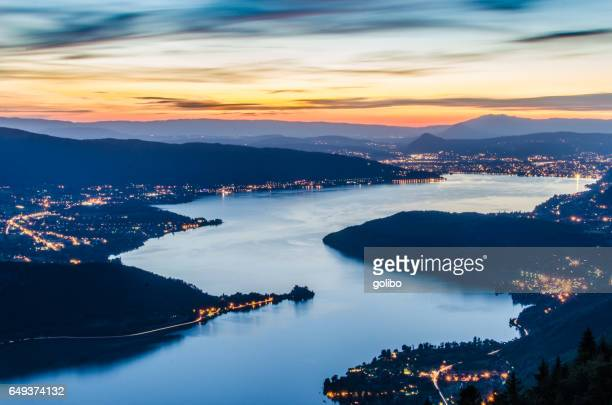 lake annecy (lac d'annecy) in france by talloires by night - lake annecy stock photos and pictures