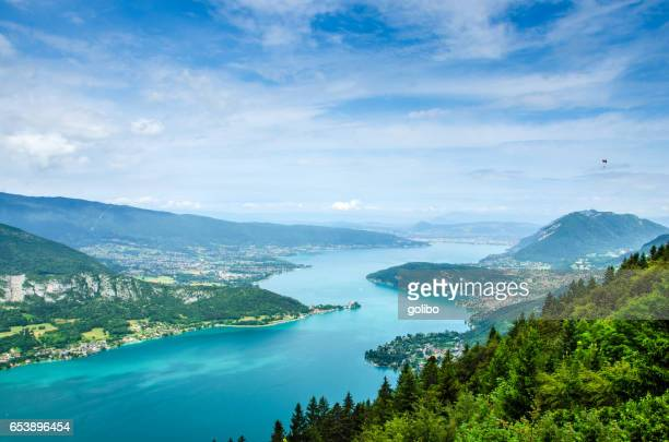 lake annecy in france seen from a viewpoint photographed on a summer day with blue sky - auvergne rhône alpes stock pictures, royalty-free photos & images