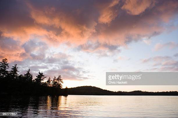 lake at sunset - hackett stock photos and pictures