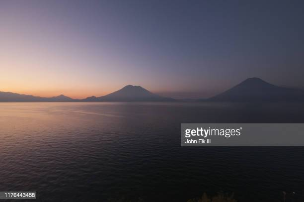 lake atitlan landscape at sunset - volcanic terrain stock pictures, royalty-free photos & images