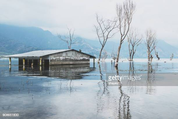 lake atitlán flooding - global warming stock pictures, royalty-free photos & images
