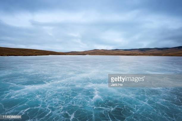 lake baikal frozen in ice - lake stock pictures, royalty-free photos & images