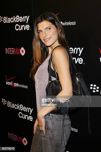 Lake Bell arrives to the launch party of the pink Blackberry Curve on the 15th Anniversary of the Intermix clothing boutique held at Intermix on...