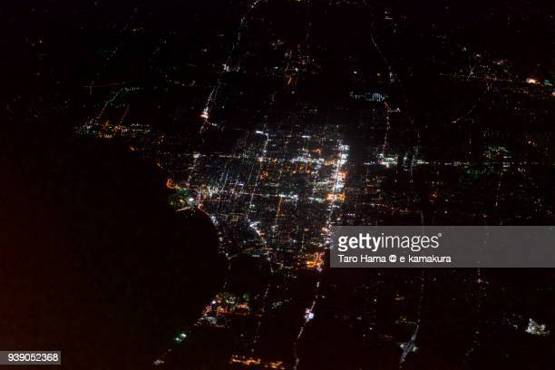 Lake Biwa and Nagahama city in Shiga prefecture in Japan night time aerial view from airplane