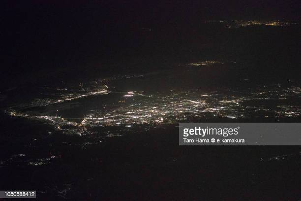 Lake Biwa in Shiga prefecture in Japan night time aerial view from airplane