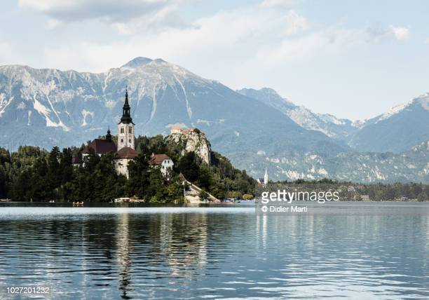 lake bled in slovenia with its famous church on the island - slovenia stock pictures, royalty-free photos & images
