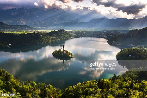 Lake Bled reflections at sunrise, Julian Alps, Gorenjska, Slovenia, Europe