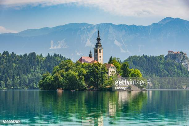 lake bled santa maria church slovenia - slovenia stock pictures, royalty-free photos & images