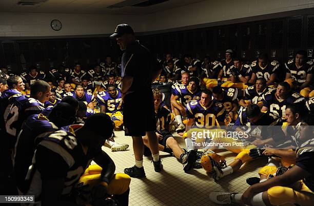 Lake Braddock head coach Jim Poythress addresses his team in the locker room before the game against Centreville at Lake Braddock High School on...