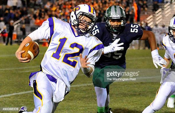 Lake Braddock quarterback Kyle Edwards runs for yardage on the keeper as South County'sSaif Khan gave chase in first half action on October 31 2014...