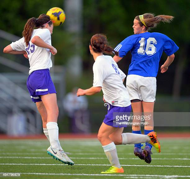 Lake Braddock's Rachel Moody, left heads the ball away from her gaol as Robinson's Katia Rabinowich, left, make an attempt asLake Braddock defeats...