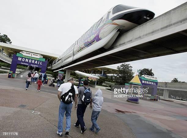 Visitors to Walt Disney World walk toward the Mono Rail train station 25 January 2007 in Lake Buena Vista Florida Disney is celebrating a Year of a...