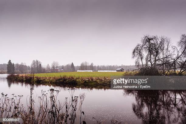 lake by field against sky - heinovirta stock pictures, royalty-free photos & images