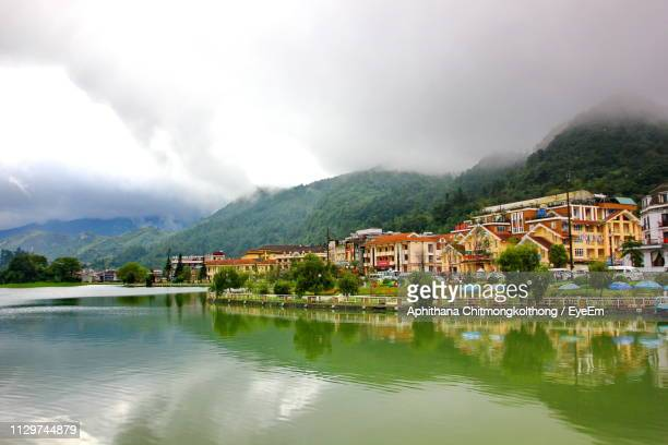 lake by townscape against sky - sapa stock pictures, royalty-free photos & images
