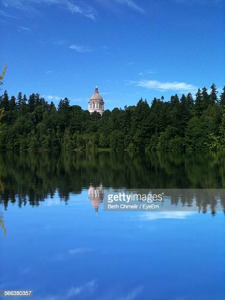 lake by washington state capitol against blue sky - olympia washington state stock pictures, royalty-free photos & images