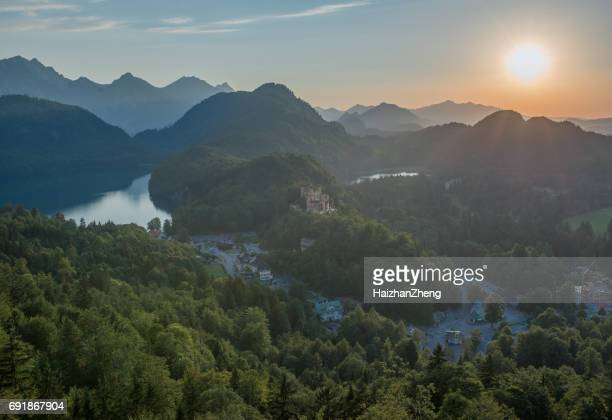 lake called alpsee and the hohenschwangau castle in bavaria - bavaria stock pictures, royalty-free photos & images