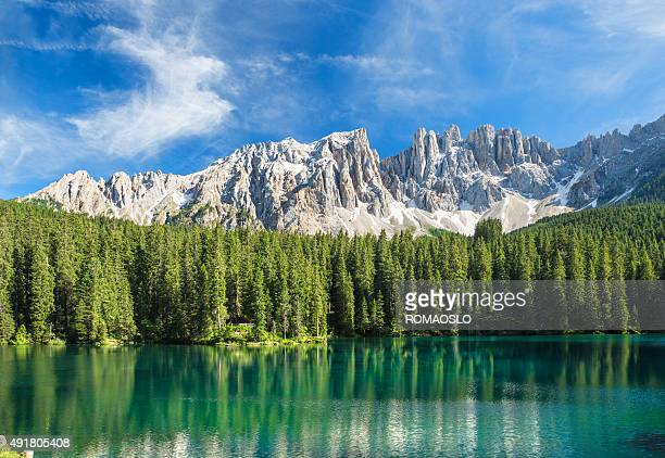 lago di carezza- karersee, trentino-alto adige, italy - dolomites stock pictures, royalty-free photos & images