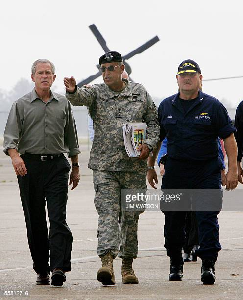 Lt General Russel Honore walk with US President George W Bush and Vice Admiral Thad Allen upon arrival at a damaged Northrup Grumman hangar 27...